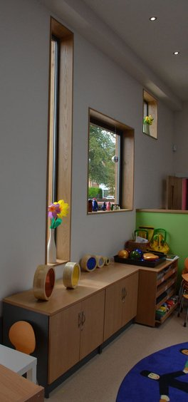 Varied window shapes bring fun to nursey play area